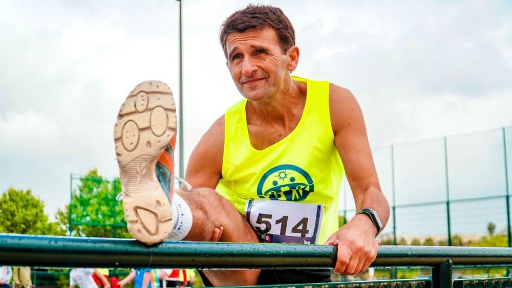 photo-of-man-stretching-before-running